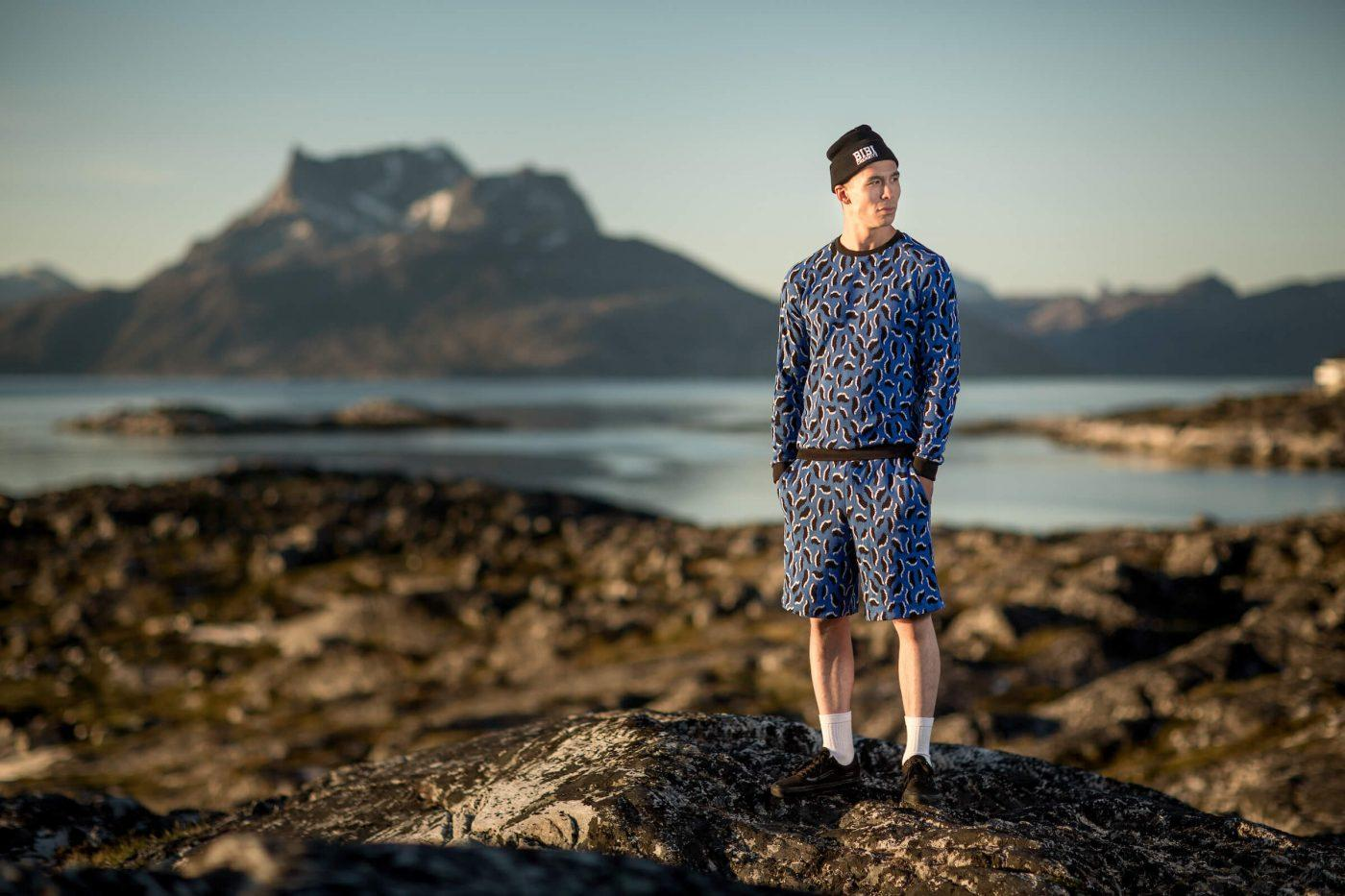 A Bibi Chemnitz clothing model from Nuuk in Greenland with the mountain Sermitsiaq behind him, by Mads Pihl