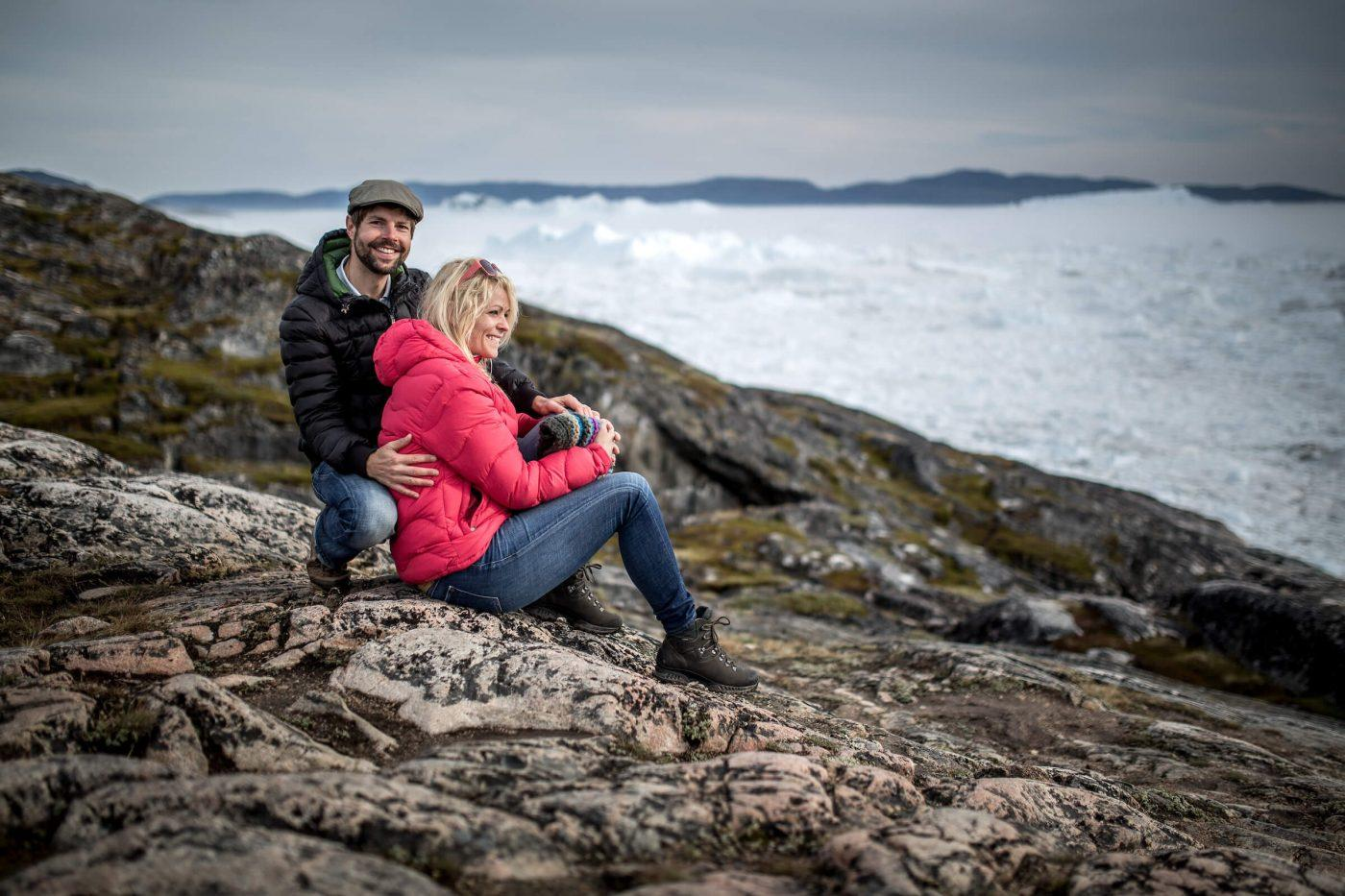 A couple overlooking the Ilulissat ice fjord near Sermermiut in Greenland. By Mads Pihl