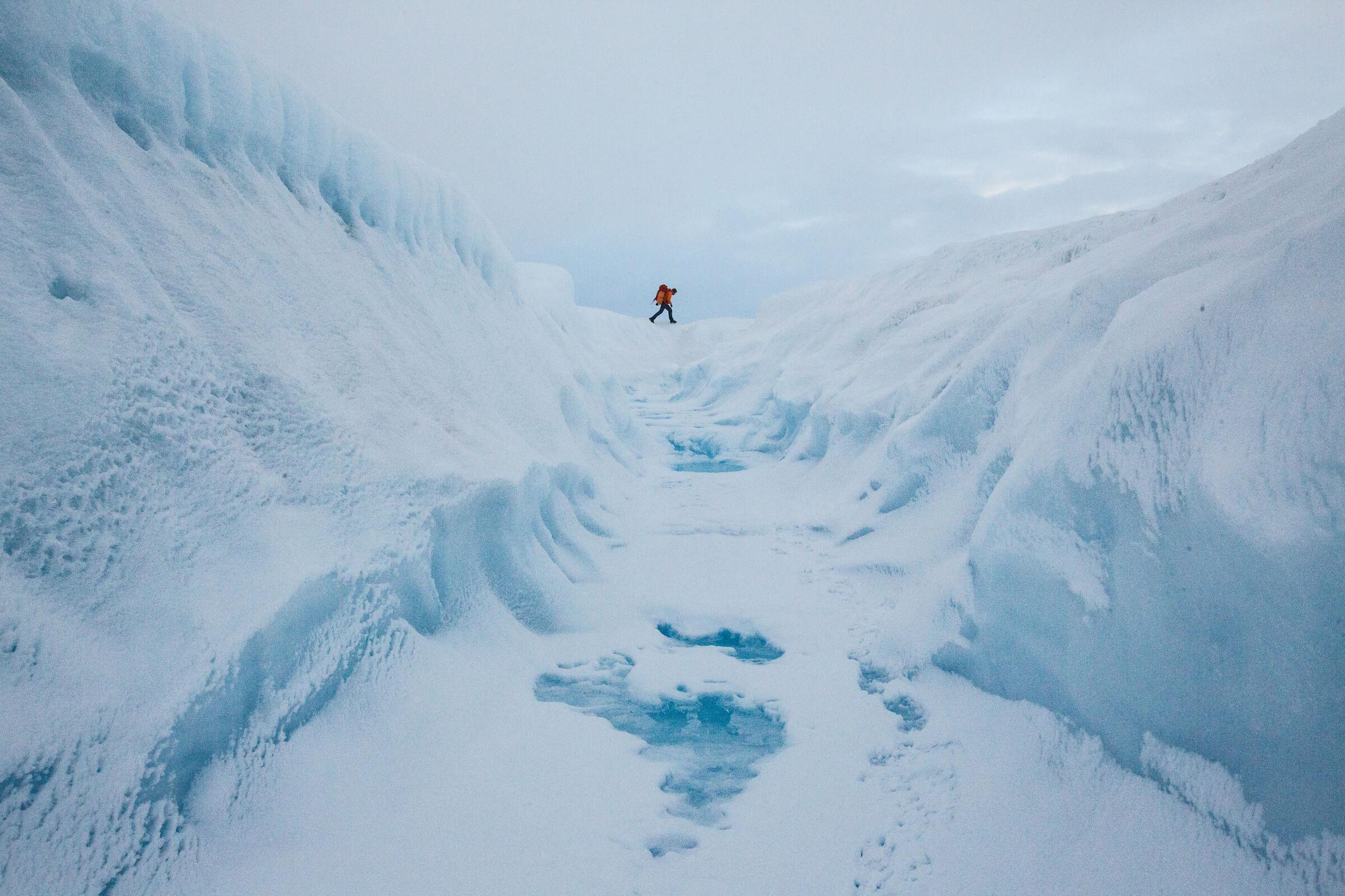 A glacier walking adventure by a crevasse on the Greenland Ice Sheet near Kangerlussuaq. By Paul Zizka