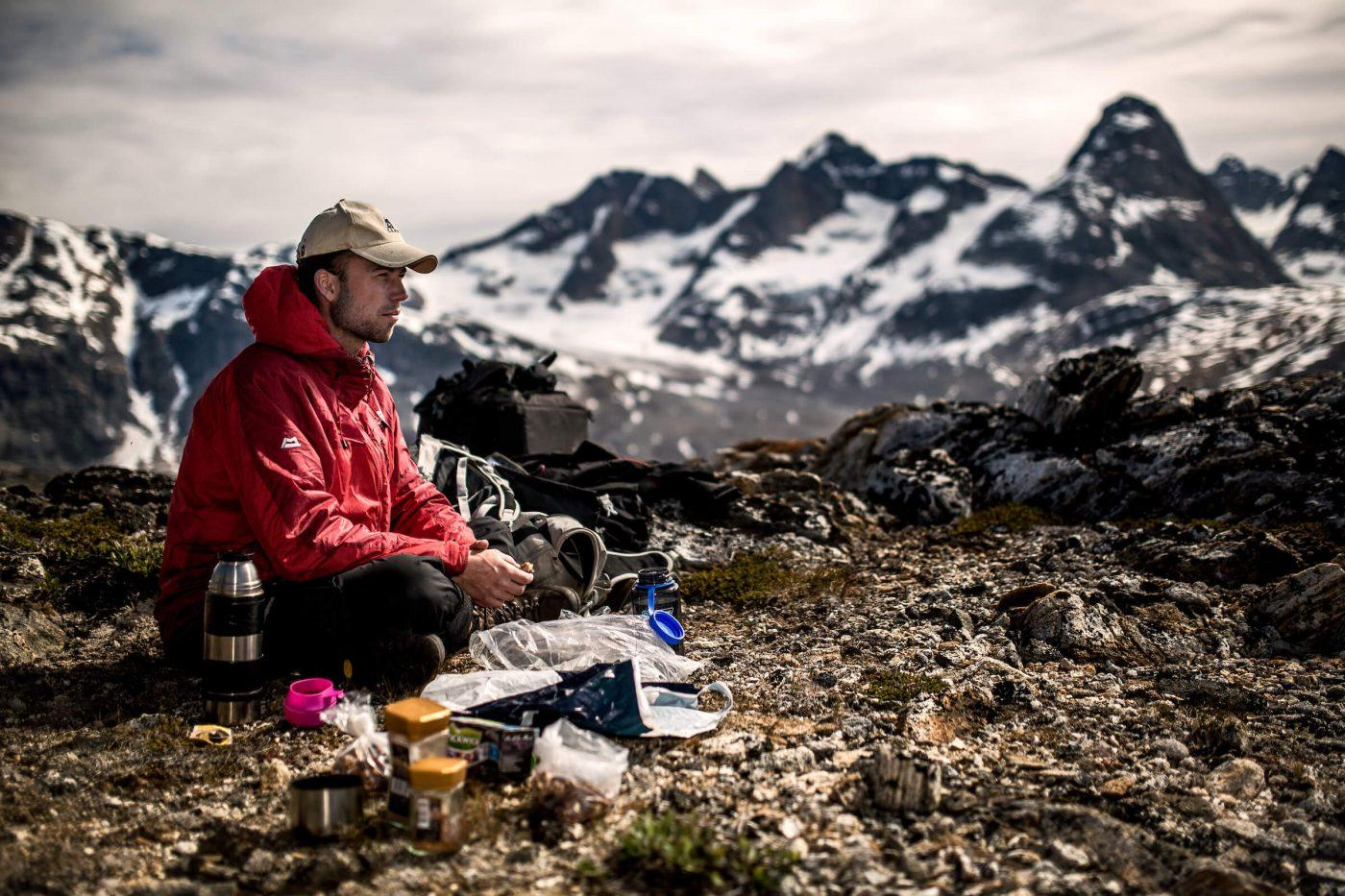 A Greenland Travel guide making coffee for his guests on a trek near Tasiilaq in East Greenland. By Mads Pihl