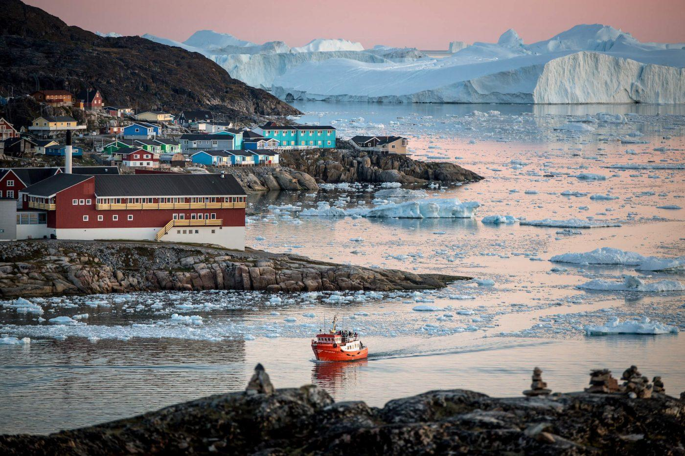 A passenger boat near Ilulissat and the ice fjord in Greenland. By Mads Pihl