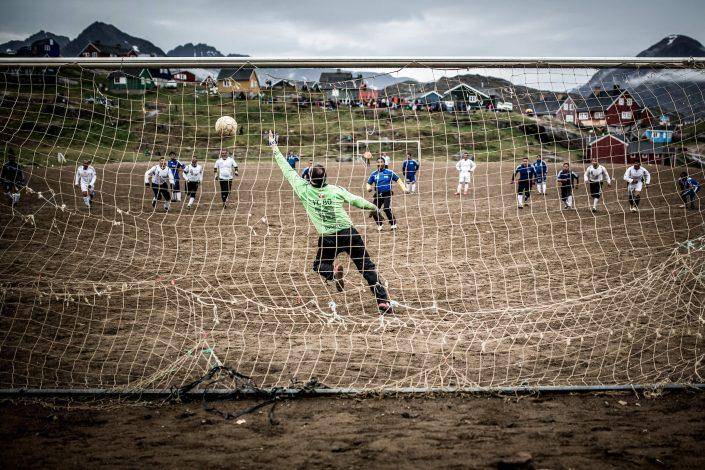 A penalty goal in the old boys final at the 2013 East Greenland soccer football championships in Tasiilaq. Photo by Mads Pihl - Visit Greenland