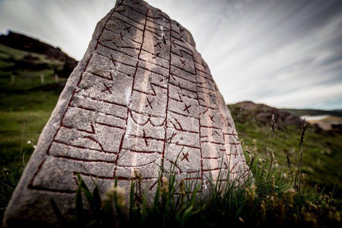 A rune stone on a hill in Qassiarsuk in South Greenland. By Mads Pihl