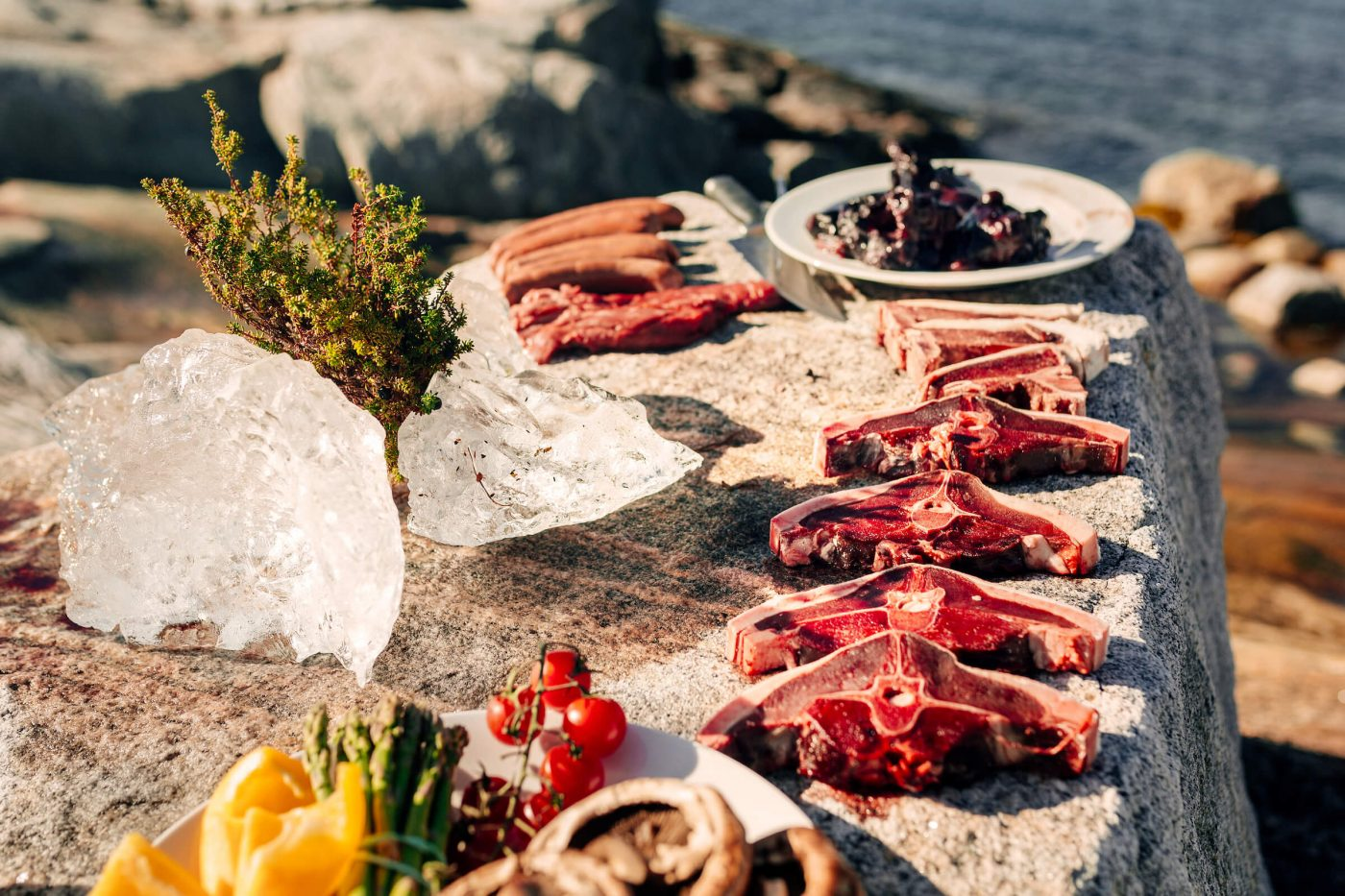 A selection of greenlandic meat being prepared on the rocks in Nuuk in Greenland. Photo by Rebecca Gustafsson - Visit Greenland