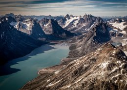 A view over the fjord leading towards the famous triplets peaks and the glacier near tasiilaq mountain hut in east greenland. By Mads Pihl
