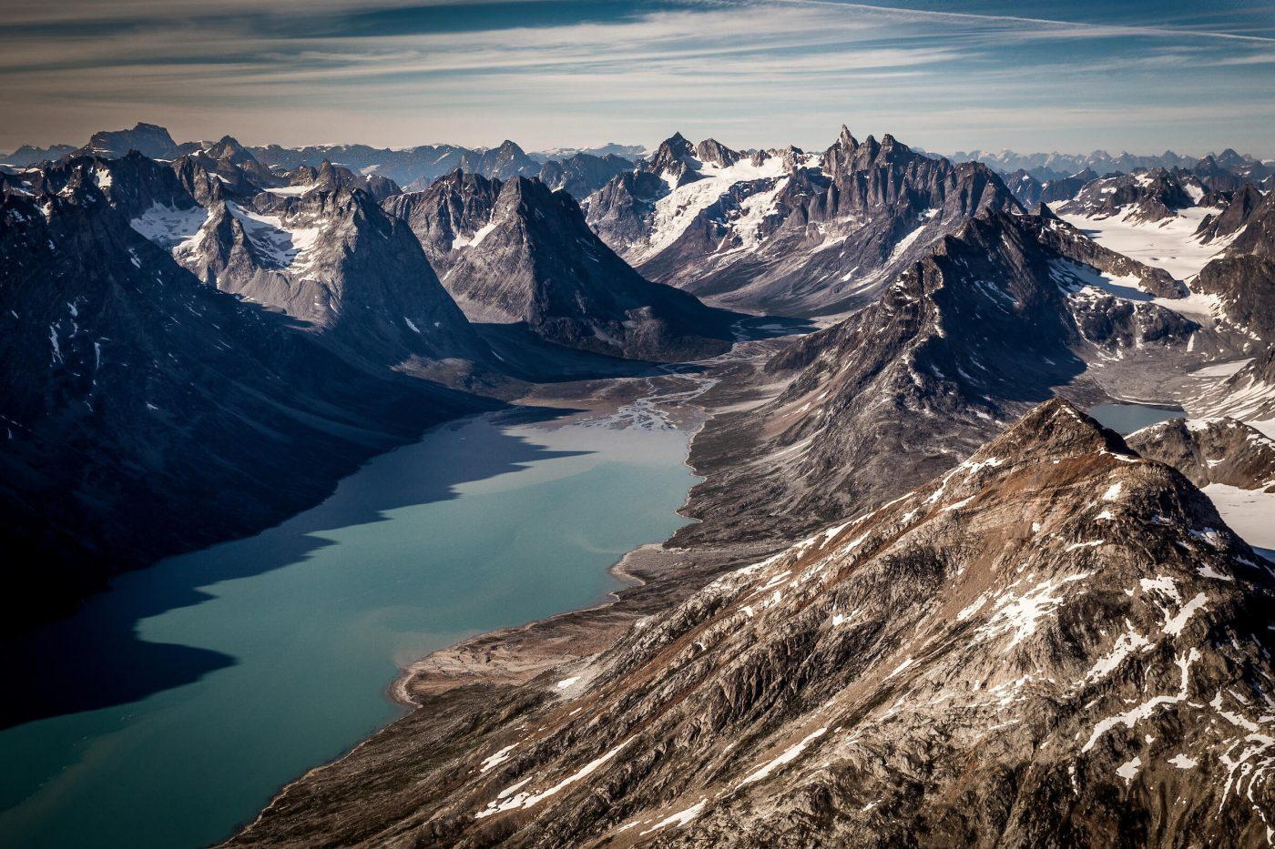A view over the fjord leading towards the famous Triplets peaks and the glacier near Tasiilaq Mountain Hut in East Greenland. Photo by Mads Pihl