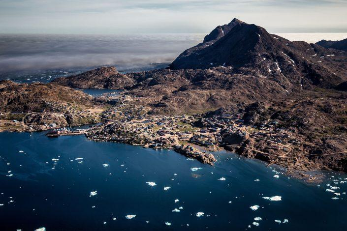 An aerial view of Tasiilaq in East Greenland seen from an Air Zafari flight. By Mads Pihl
