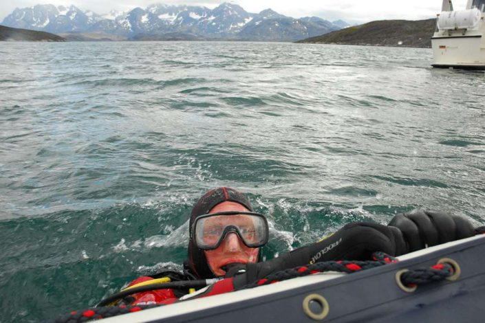 Scuba diver in the water near Sisimiut. Photo by Sirius Greenland, Visit Greenland