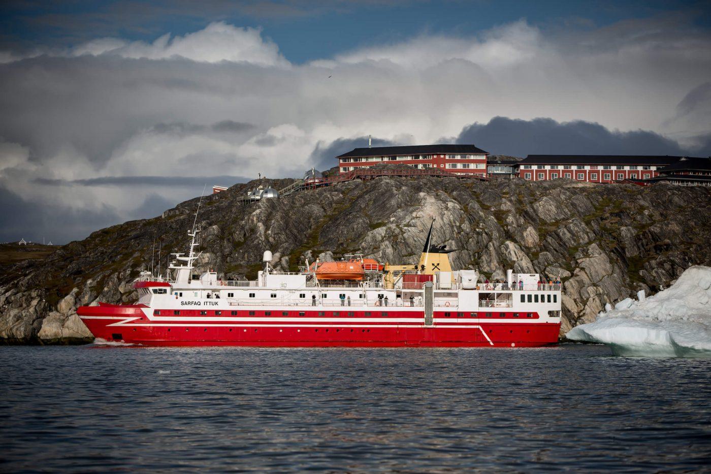 Sarfaq Ittuk passing underneath Hotel Arctic near Ilulissat in Greenland. Visit Greenland