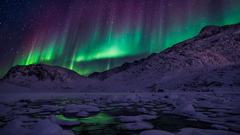 Northern Lights over Mount Nasaasaaq in Sisimiut in Greenland