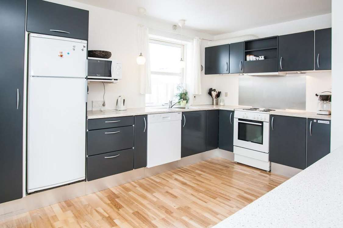 Fully equipped kitchen with modern appliances. Photo by Bed & Breakfast Paa and Jannik