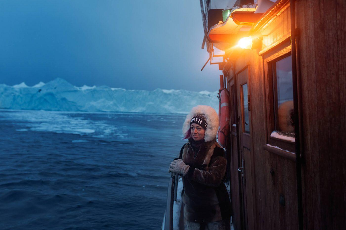 Canadian social media influencer Kristen Sarah on an iceberg boat tour in the Ilulissat icefjord in Greenland. By Rebecca Gustafsson