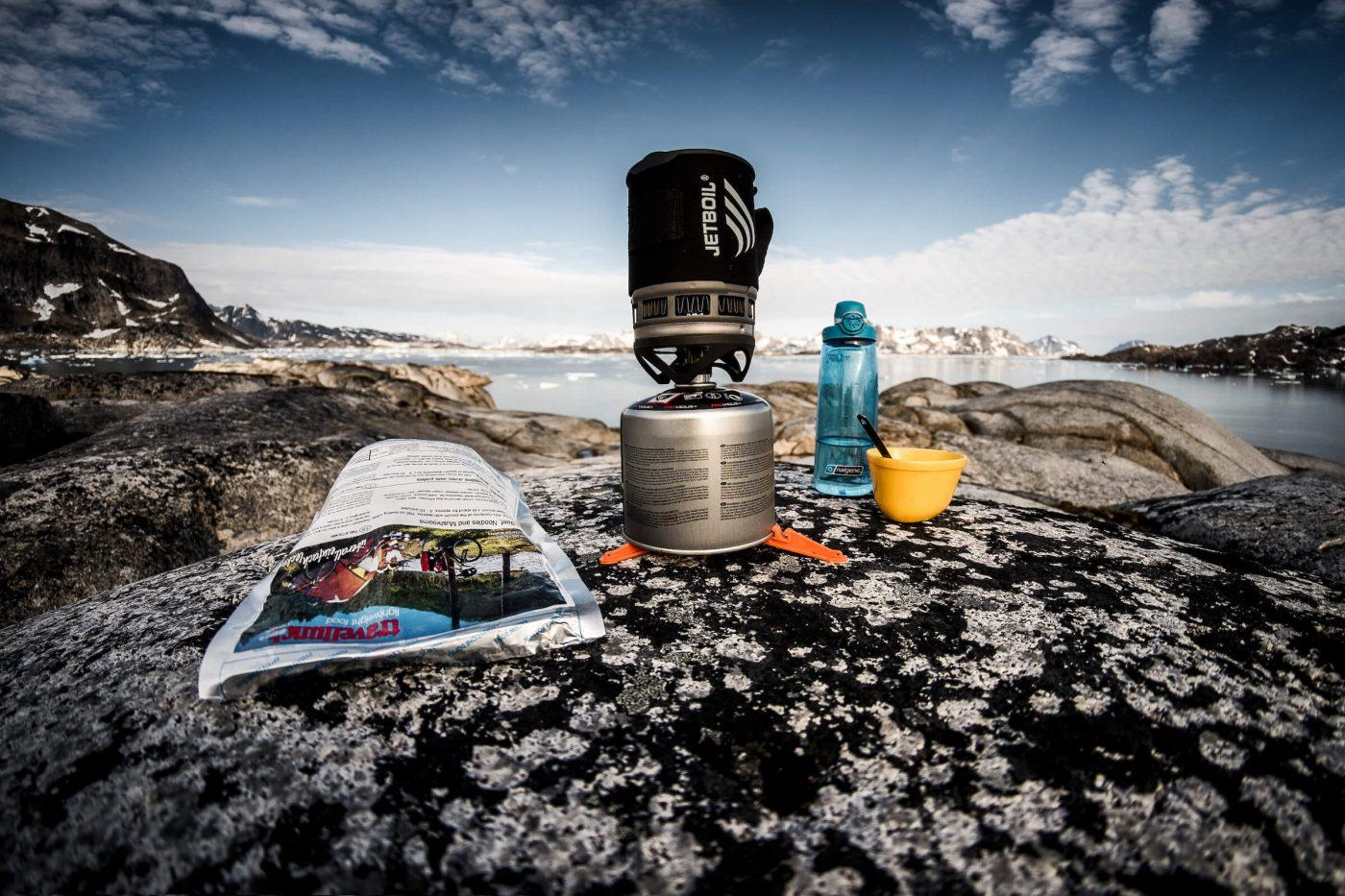 Cooking gear and freeze dried food on a rock near Kulusuk in East Greenland. By Mads Pihl