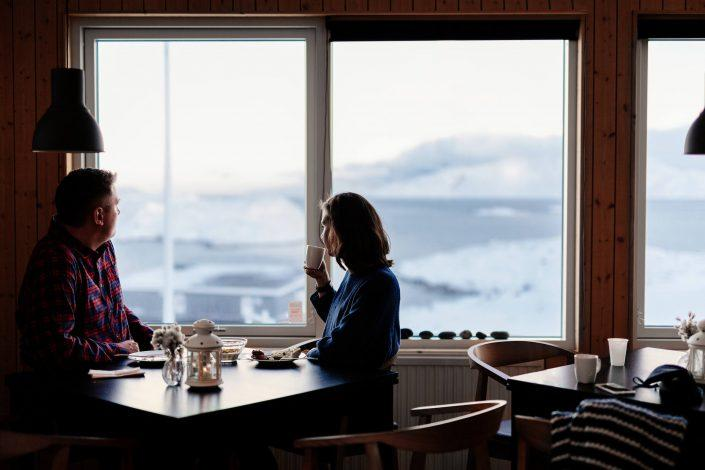 Couple enjoying a brunch at Inuk Hostels in Nuuk in Greenland. By Rebecca Gustafsson