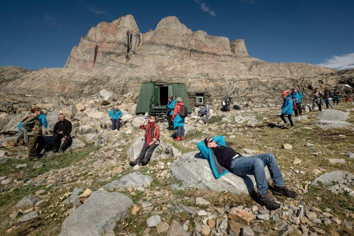 Cruise guests from MS Fram relaxing outside the Santa Claus cabin in Uummannaq in Greenland. Photo by Mads Pihl