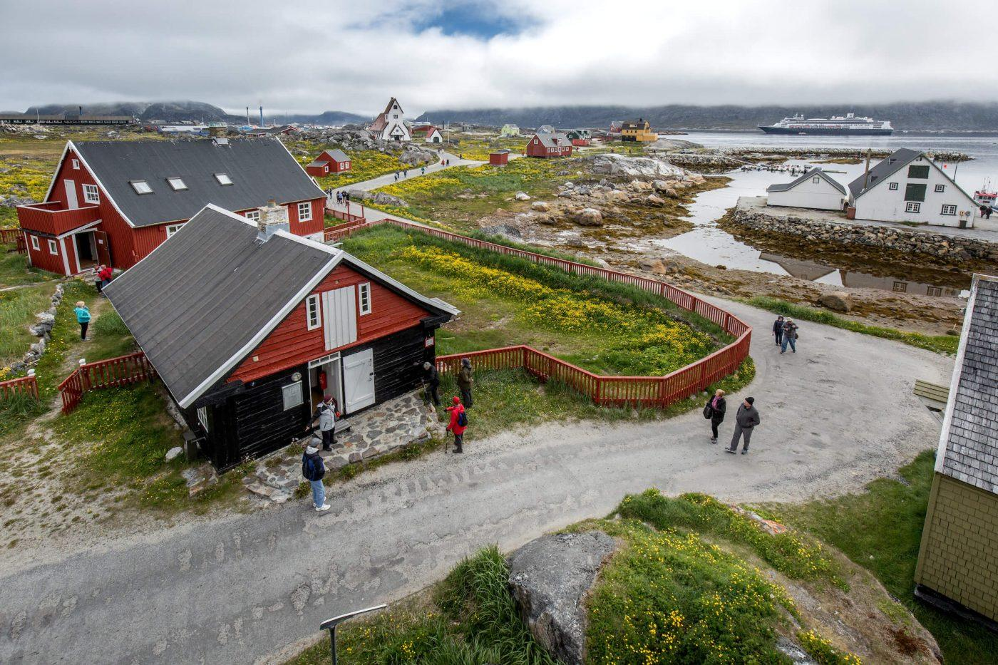 Cruise guests from the ship Rotterdam visiting the old museum area of Nanortalik on South Greenland. By Mads Pihl