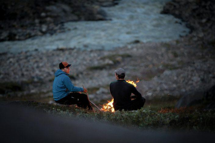 Enjoying a campfire with Greenland Outdoors near Kangerlussuaq in Greenland. By Mads Pihl