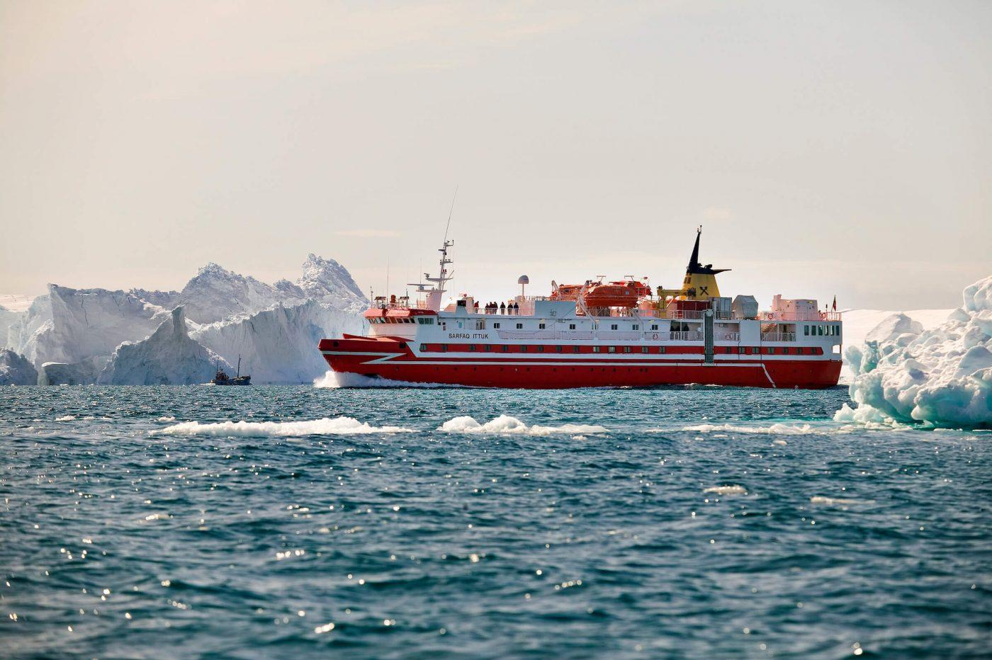 Fishing trawler and coastal ferry Sarfaq Ittuk among icebergs in Ilulissat Icefjord in Greenland