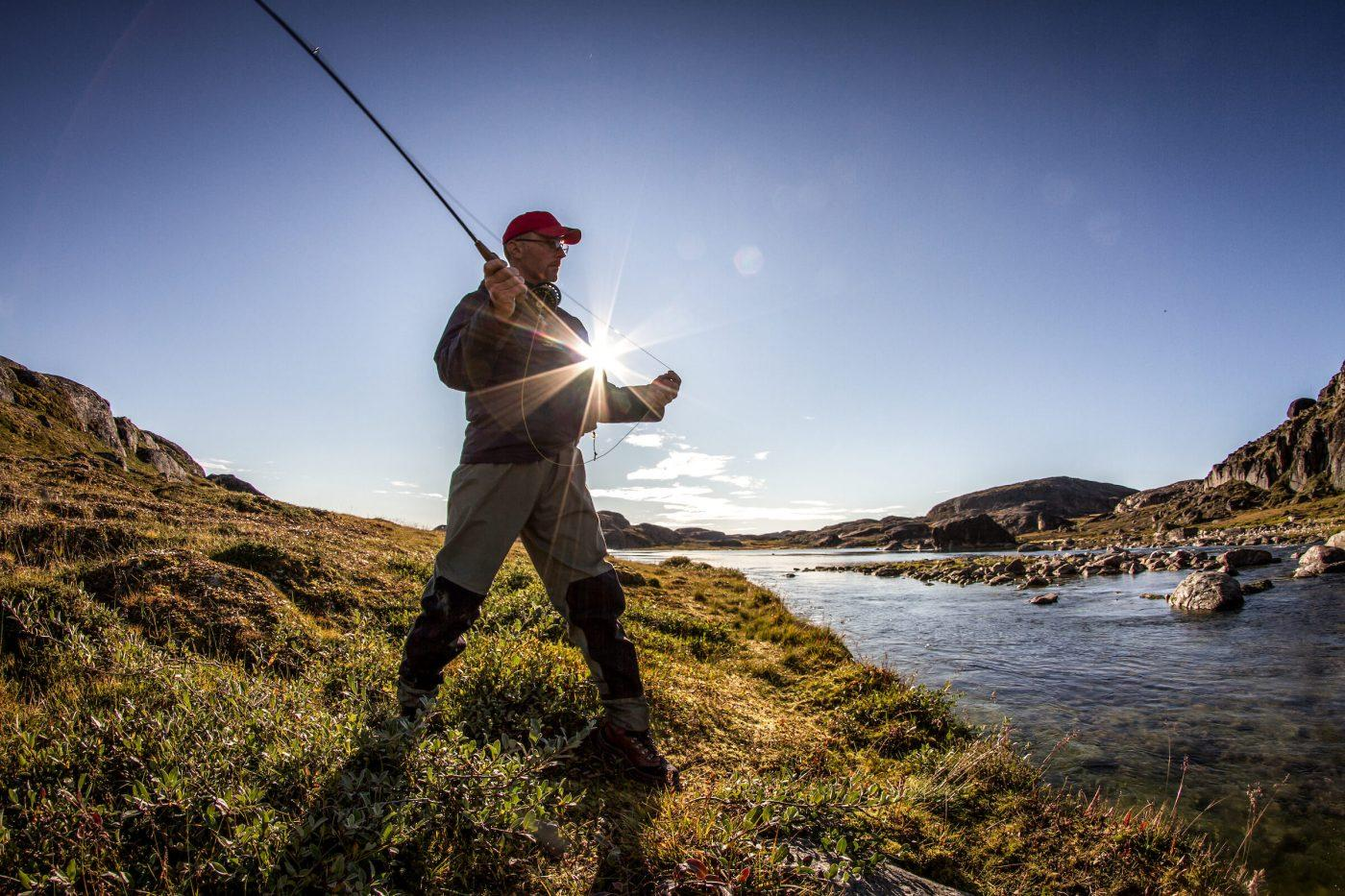 Fly fishing at Erfalik river in Greenland. By Mads Pihl