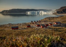 An overview of the Eqi Glacier Lodge camp with the glacier in the background in North Greenland