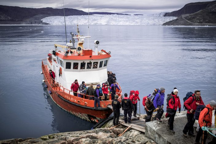 Passengers disembarking at Eqi Glacier Lodge in Greenland. Photo by Mads Pihl, Visit Greenland