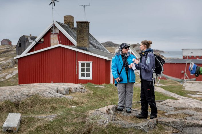 Greenland Cruises- A tour guide and a guest in the abandoned settlement Assaqutaq near Sisimiut in Greenland