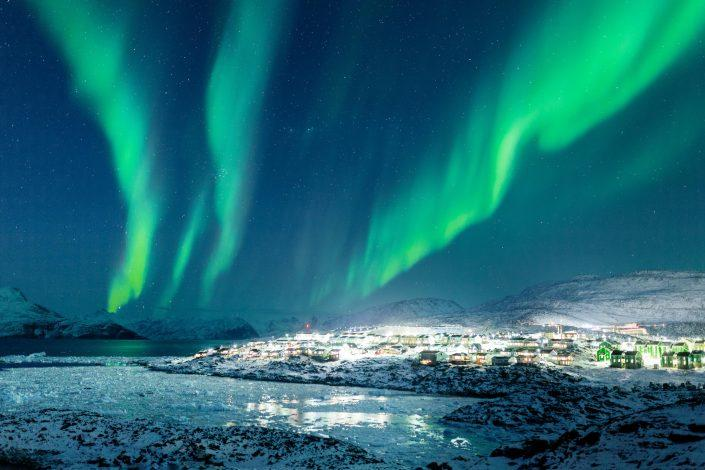 Northern Lights over the city lights of Nussuaq, Nuuk in Greenland. Photo by Rebecca Gustafsson