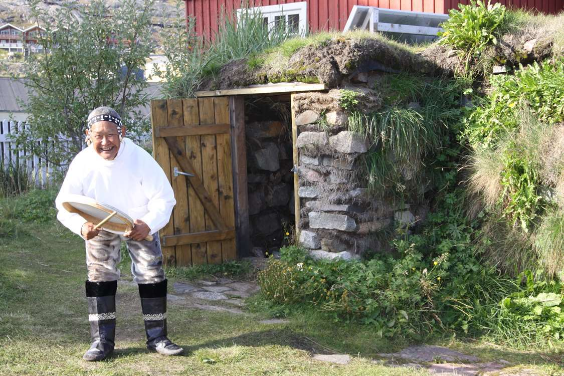 Drum dancer smiling in Qaqortoq in South Greenland. Photo by Greenland Sagalands