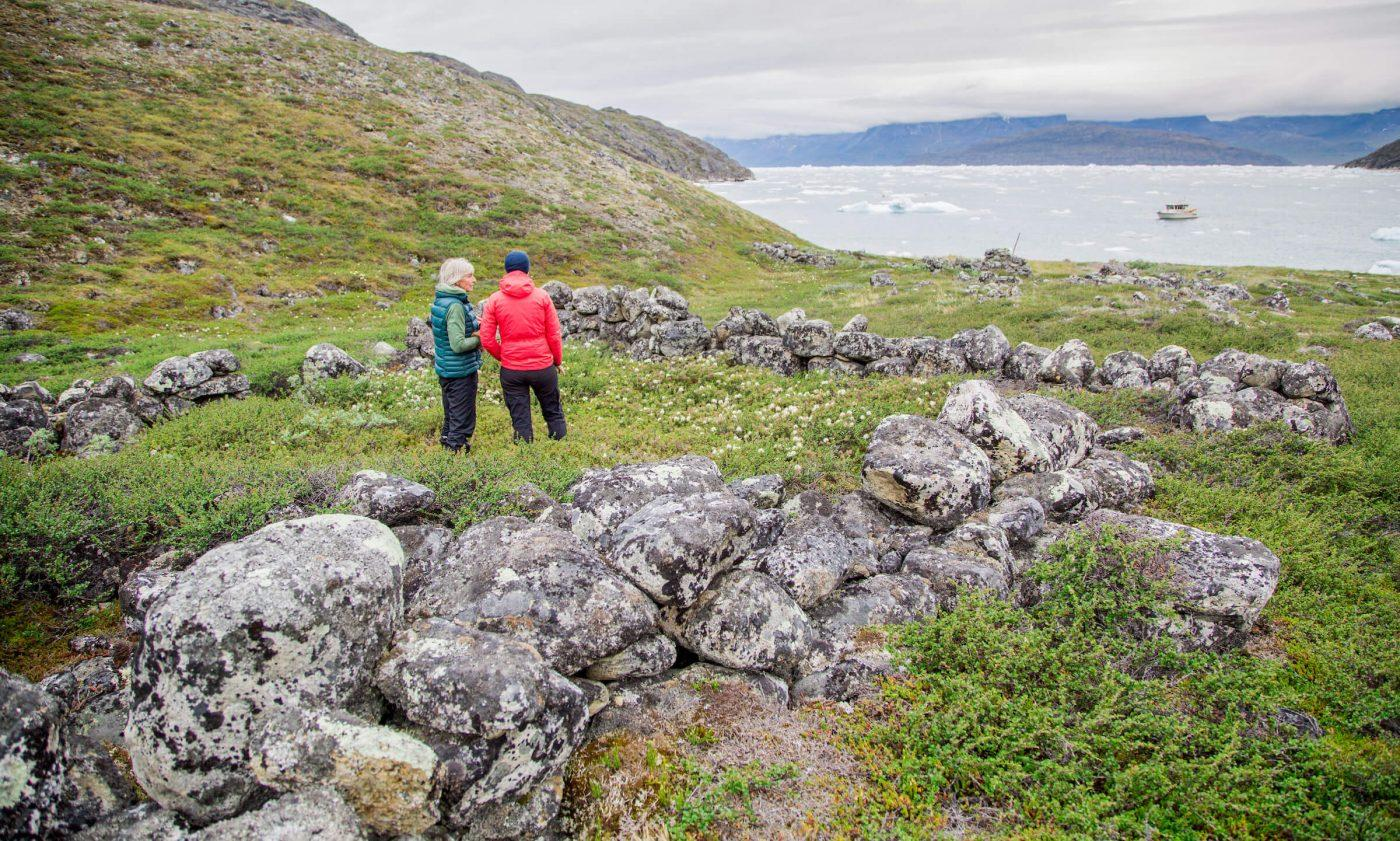 Guests at the Arctic Nomad Adventure Camp out on a daytime boat tour to discover the history of Norse ruins in Nuuk Fjord. By Raven Eye Photography