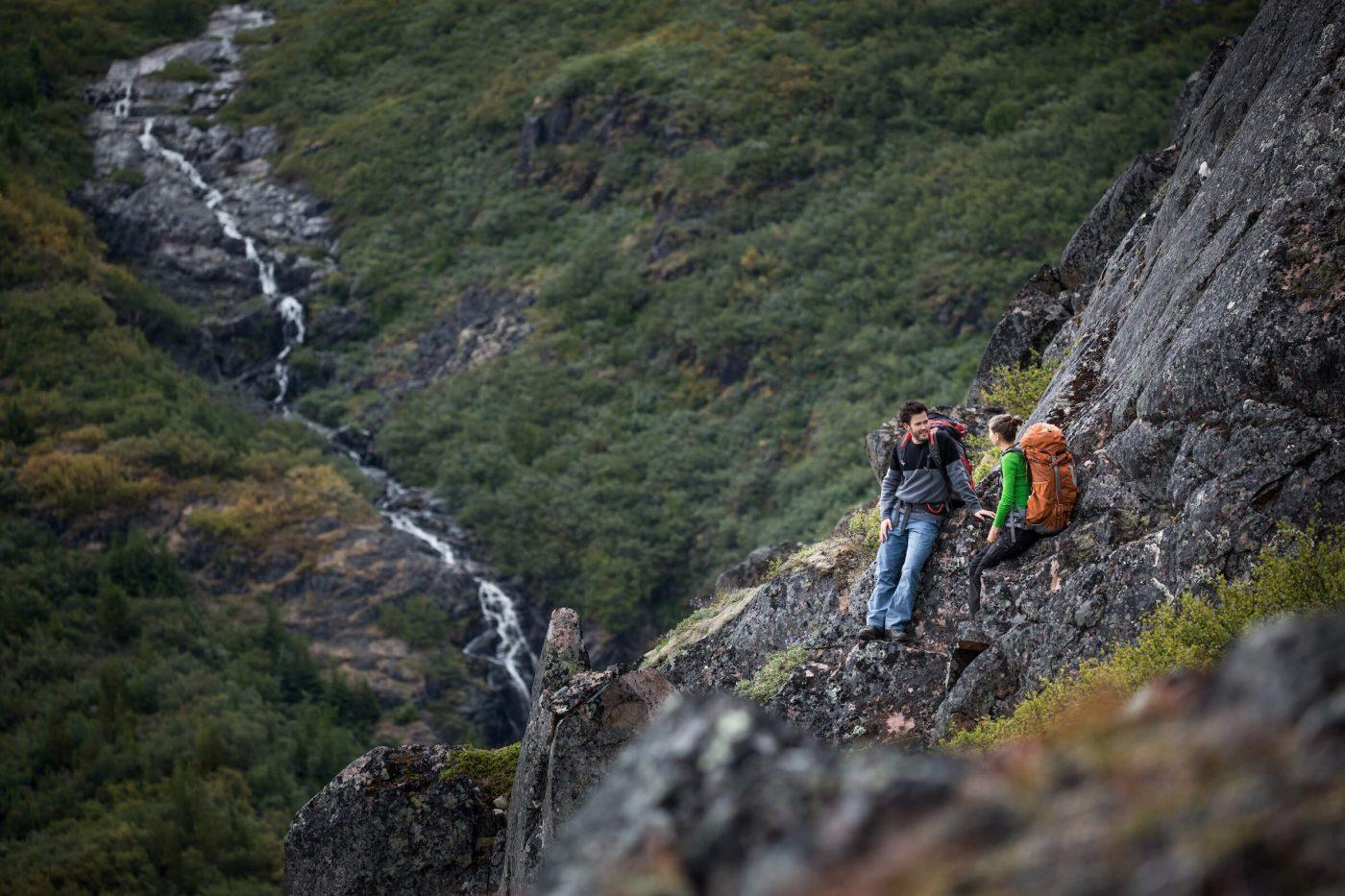 Hikers near a waterfall in Narsarsuaq. By Mads Pihl