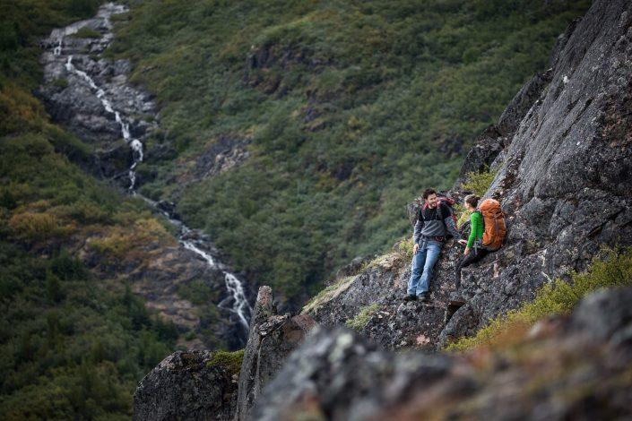 Hikers near a waterfall in Narsarsuaq. By Mads Pihl
