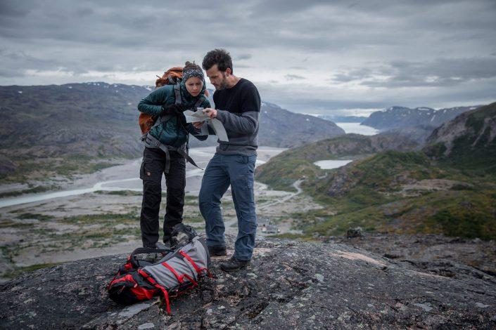 Hikers studying a map in Narsarsuaq. By Mads Pihl