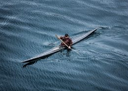 History - A kayaker from Sisimiut in Greenland in a traditional skin kayak