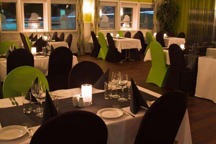 Tables in the Hotel Sisimiut Restaurant set-up for dinner. Photo by Hotel Sisimiut, Visit Greenland
