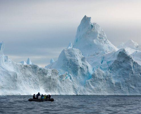 I photographed this group of photographers in the Disko Bay one early morning. I still think they were pushing the limits a little bit with regards to how close to the edge of ice they seem to be, but I'm guessing the captain was in 100% control. By Stian Klo