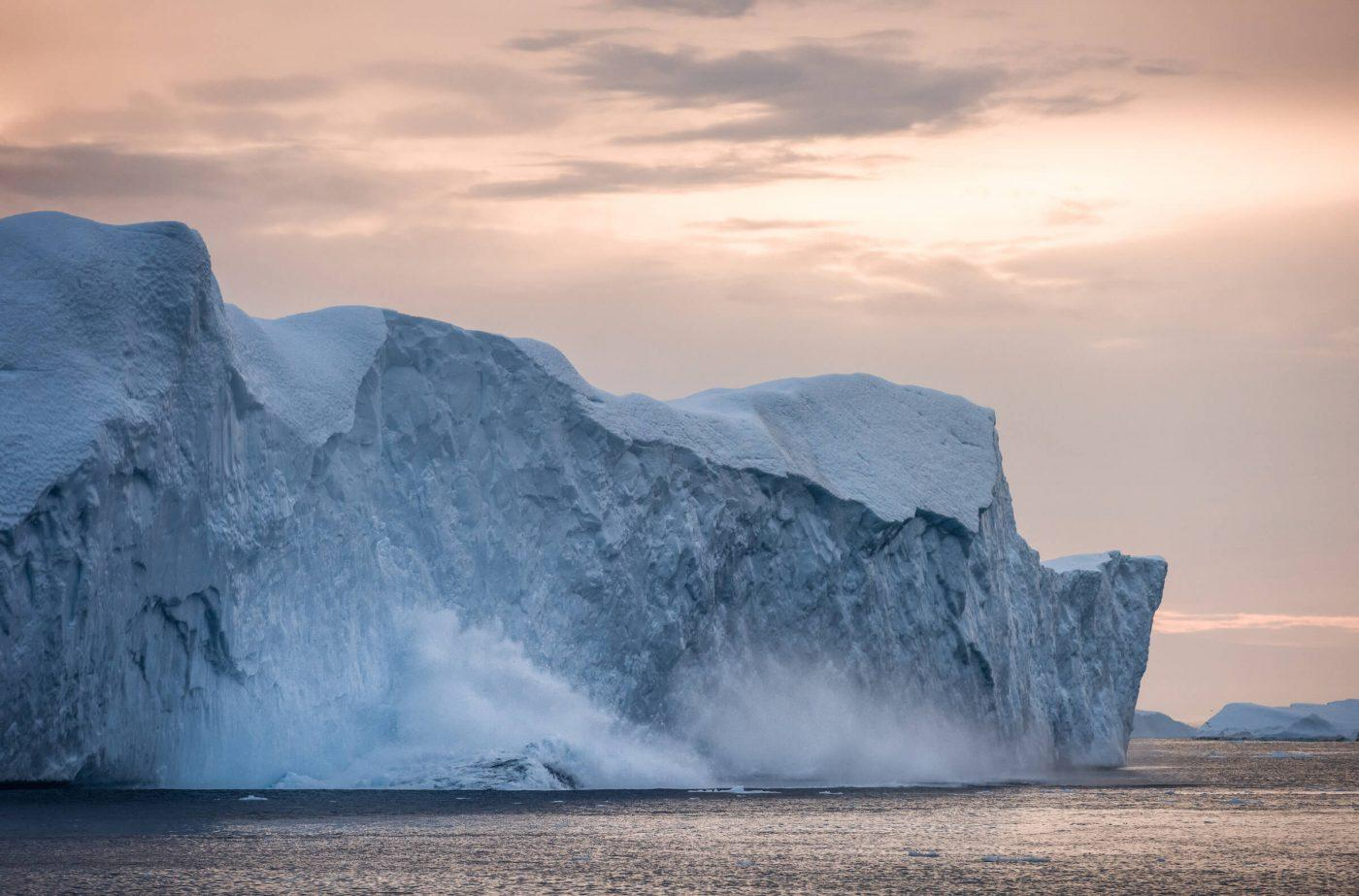 I was fortunate to be at the right place at the right time on two occassions with regards to photographing a calving iceberg in the Ilulissat Icefjord. An amazing experience. Photo by Stian klo