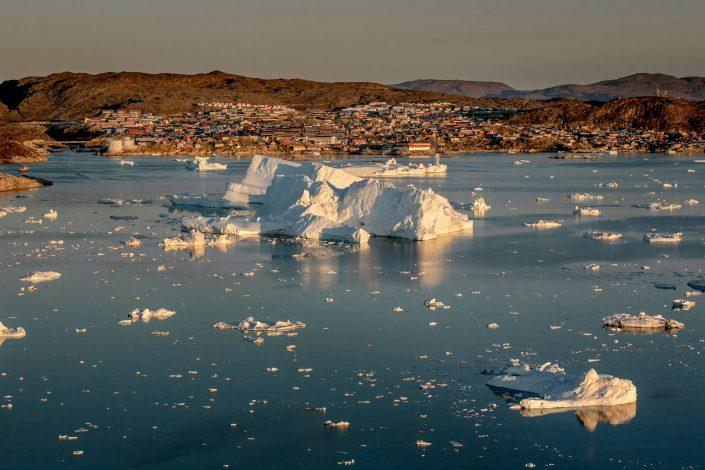 Ilulissat in Greenland with icebergs from the ice fjord outside in the Disko Bay. Photo by Mads Pihl