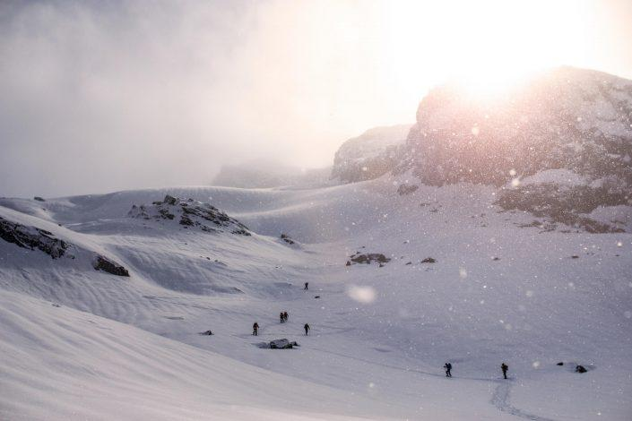 Snowfall with skiers ski touring near Kangaamiut. By Jesper Regin