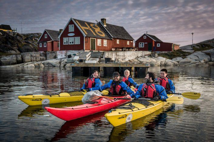 Kayakers from PGI Greenland in front of Restaurant H8 in Oqaatsut in Greenland. Photo by Mads Pihl