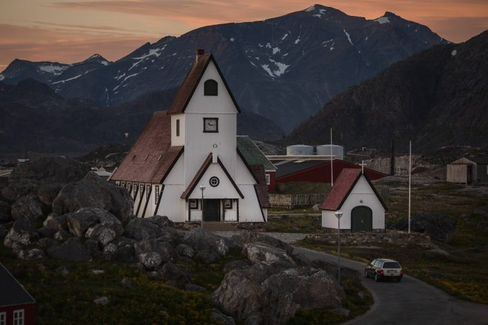 An evening view of the white church in Nanortalik in South Greenland. Photo by Mads Pihl - Visit Greenland