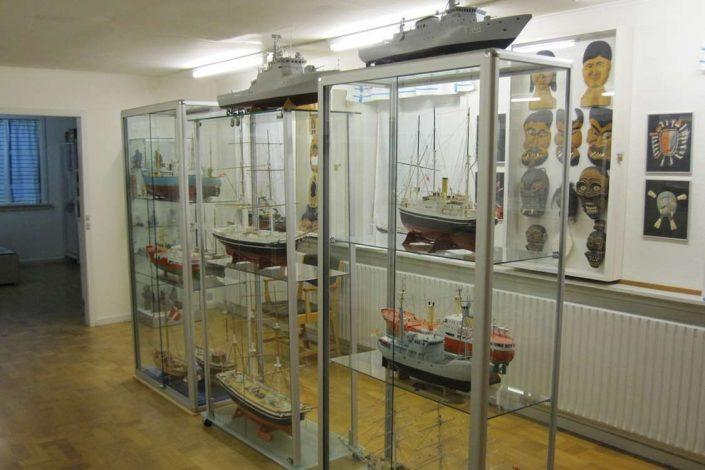 Miniature ships and Greenlandic masks at display in South Greenlandic museum. Photo by Nanortalik Museum