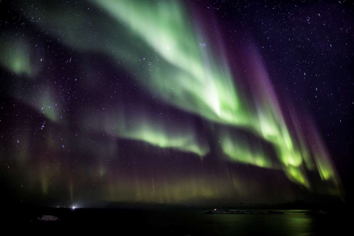 Northern Lights also known as Aurora Borealis filling up the night sky. Photo by Nanu Travel