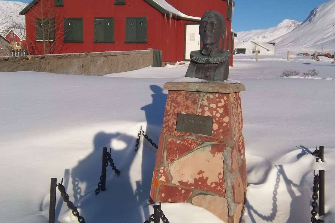 Statue of the Greenlandic artist and priest, Henrik Lund, in a snow-covered Narsaq, South Greenland. Photo by Narsaq Museum