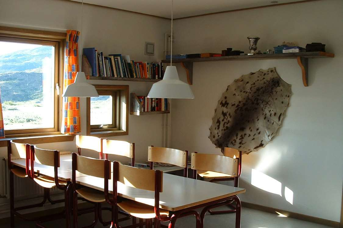 Dining area in Narsarsuaq Hostel with sealskin hanging on the wall. Photo by Blue Ice Explorer