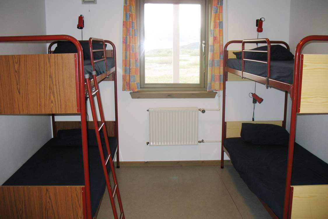 Room with two bunkbeds at Narsarsuaq Hostel. Photo by Blue Ice Explorer