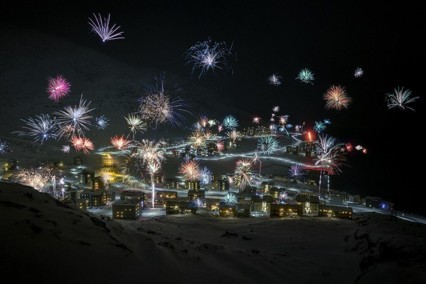 New Year's Eve lights up over the Nuuk suburb Qinngorput in Greenland. Photo by Mads Pihl