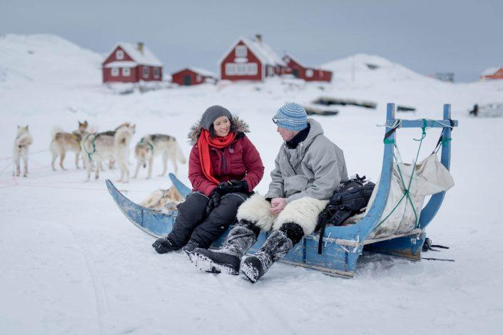 A Chinese traveler and her Greenlandic guide on a dog sledding trip in Oqaatsut. Photo by Mads Pihl - Visit Greenland