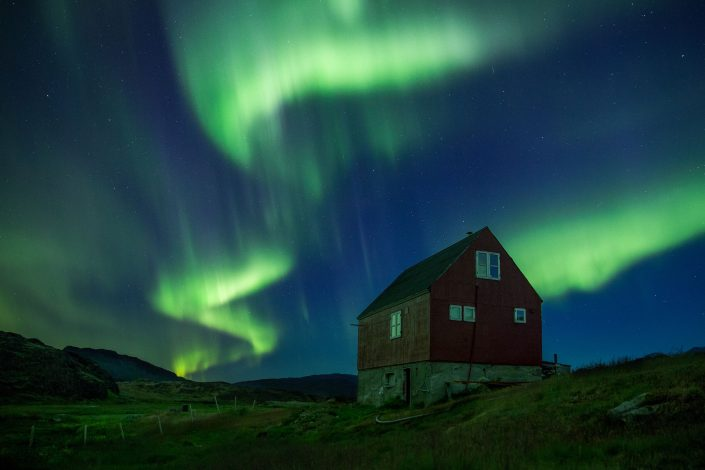 Northern lights over Sermilik Hostel at Tasiusaq sheep farm in South Greenland