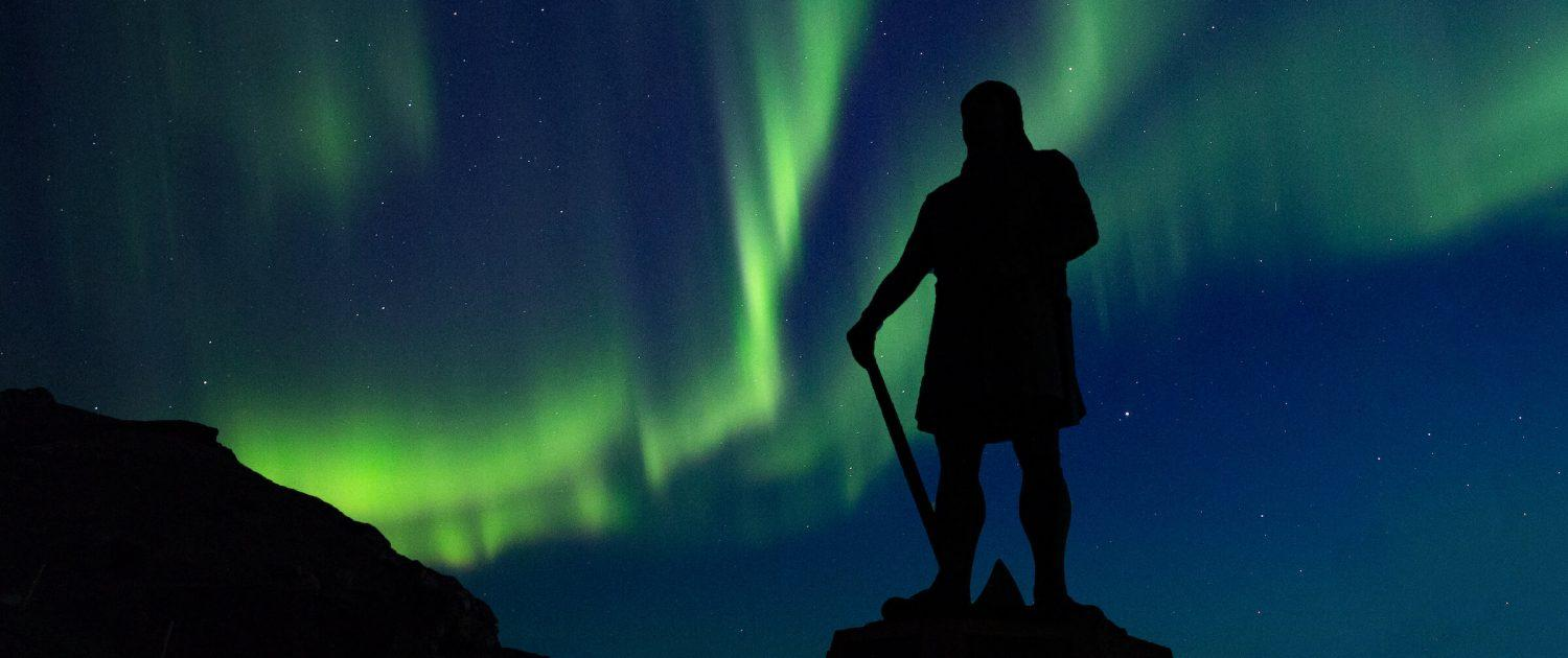 Northern lights over the Leif Ericson statue in Qassiarsuk in South Greenland. Photo by Mads Pihl - Visit Greenland