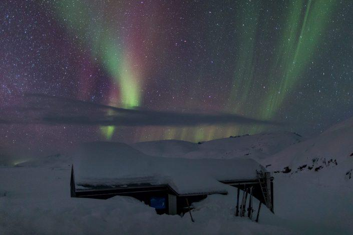Northern lights over the Travellodge Greenland hut at Sermilik Ice fjord in East Greenland